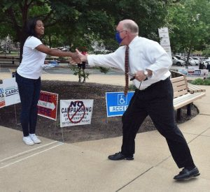 Former Virginia Del. and gubernatorial candidate Jennifer Carroll Foy (left) greets voter Rick Whelan of Alexandria outside a polling site on June 8, the date of the primary election in Virginia. (Robert R. Roberts/The Washington Informer)