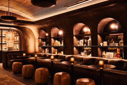The dLeña ROJA lounge, located on the lower level of dLeña Wood-Fire Mexican Cocina & Mezcaleria restaurant in D.C.'s Mt. Vernon Triangle, is designed with comfortable leather seating. (Photo by Zeph Colombatto)