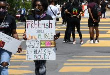 """**FILE** In 2020, two blocks on 16th Street between K and H Streets in northwest D.C. was renamed """"Black Lives Matter Plaza."""" People celebrated Juneteenth on the Plaza protesting the murder of George Floyd. (Roy Lewis/The Washington Informer)"""