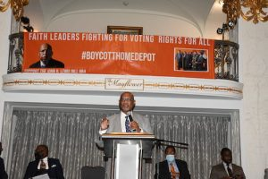 """Bishop Reginald T. Jackson, presiding prelate of the Sixth Episcopal District of the African Methodist Episcopal Church in Georgia, speaks during the """"My Vote is Sacred"""" rally, held in support of the John Lewis Voting Rights Act, at the Mayflower Hotel in northwest D.C. on June 15. (Roy Lewis/The Washington Informer)"""