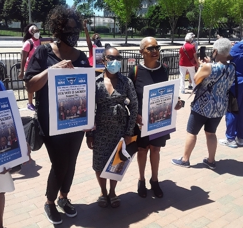 """Demonstrators protest outside the White House on June 16 as part of the """"My Vote is Sacred"""" rally, held in support of the John Lewis Voting Rights Act. (Photo by Darwin Curry)"""