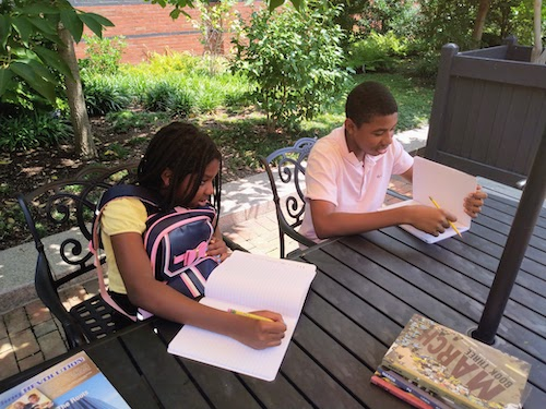 From left: Rielle Bernard and Rahsaan Bernard Jr. enjoy the home-school experience while out and about in downtown D.C. (Sam P.K. Collins/The Washington Informer)