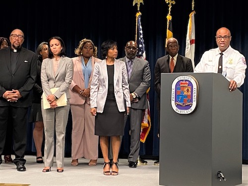 Prince George's County Police Chief Malik Aziz (at lectern) speaks during a July 22 press conference to announce the terms of a settlement with current and former Black and Latino police officers in a discrimination lawsuit. (William J. Ford/The Washington Informer)