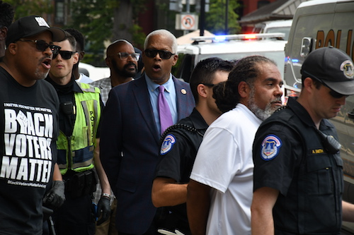 Black male activists are arrested in front of the Hart Senate Office Building on July 22 for protesting legislative inaction on voting rights bills. (Roy Lewis/The Washington Informer)