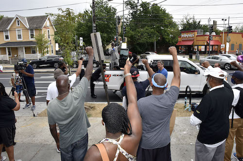Rallygoers listen to speakers during a July 24 anti-violence rally in southeast D.C. in front of the site where 6-year-old Nyiah Courtney was killed in a drive-by shooting days earlier. (Robert R. Roberts/The Washington Informer)