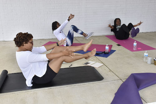 Shannon Martin (left) instructs teen yoga students Zya Berlack and Layah Stoutamire with various yoga positions. (Robert R. Roberts/The Washington Informer)