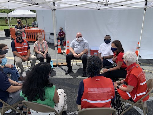 Volunteers with the Federal Emergency Management Agency and the Peace Corps operate a mobile coronavirus vaccination unit at Lakeforest Mall in Gaithersburg, Maryland, on July 10. (Courtesy of FEMA Region 3 via Twitter)