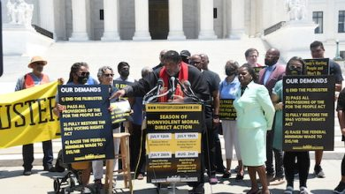 The Rev. Dr. William J. Barber III holds the first Moral Monday protest on July 12 and announces the schedule of protests for the Poor People's Campaign being held through August in front of the U.S. Supreme Court. (Roy Lewis/The Washington Informer)