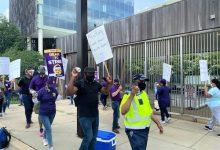 Custodial workers and members of 32BJ SEIU demonstrate in front of the U.S. Census Bureau building in Suitland, Maryland, on July 15 in protest against the agency's new cleaning contractor, Alutiiq Logistics and Maintenance Services. (William J. Ford/The Washington Informer)