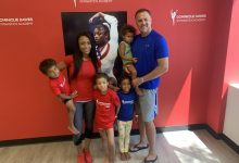 Dominique Dawes and her husband Jeff share a moment with their children at her academy in Clarksburg, Md.