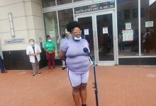 Tatiyana Graham speaks during an Aug. 2 news conference outside the D.C. Department of Housing and Community Development Resource Center on the city's STAY DC rental assistance program, which she said helped keep her family housed. (James Wright/The Washington Informer)