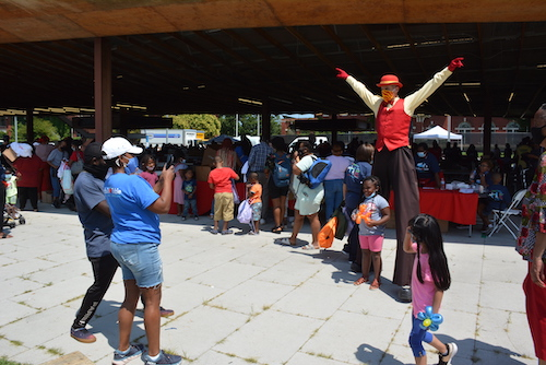 Throngs of people participate in the Martha's Table school giveaway at the Gateway Pavilion on the campus of St. Elizabeths. (Roy Lewis/The Washington Informer)