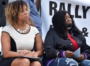 Baltimore City State's Attorney Marilyn Mosby (left) listens to speeches at an Aug. 2 rally sitting beside Tamika Palmer, mother of 26-year-old Breonna Taylor, who was shot and killed by police in Louisville in March 2020. (Robert R. Roberts/The Washington Informer)