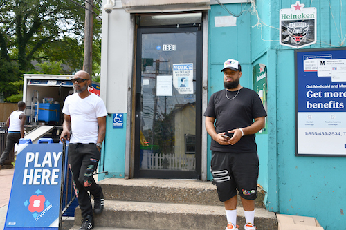 """Nazcia Ransford (left) and """"Presto"""" stand in front of King Convenience Store on 16th and U streets in southeast D.C. (Anthony Tilghman/The Washington Informer)"""