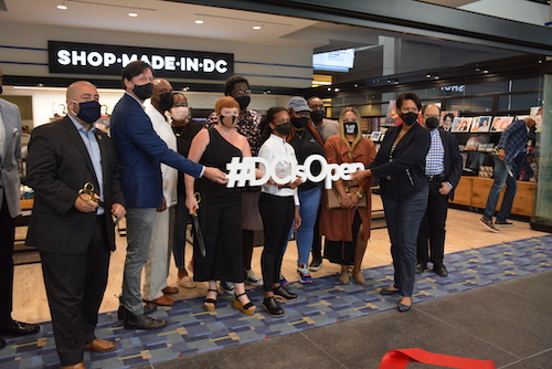D.C. Mayor Muriel Bowser (second from right) takes part in a ribbon-cutting ceremony for Shop Made In D.C., a locally owned vendor, at the newly reopened Walter E. Washington Convention Center in the District on Aug. 4. (Roy Lewis/The Washington Informer)