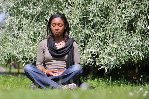 A woman meditates for relaxation and reflection. (Courtesy photo)