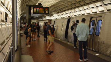 Metro riders board a train at Dupont Circle. (Roy Lewis/The Washington Informer)
