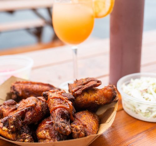 Smoked wings with a choice of dry rub or honey sriracha sauce is one of the signature dishes at All Set Restaurant and Bar in Silver Spring, Md. The establishment is one of more than 200 restaurants participating in Restaurant Association Metropolitan Washington's Summer Restaurant Week this year. (Courtesy of Restaurant Association Metropolitan Washington)