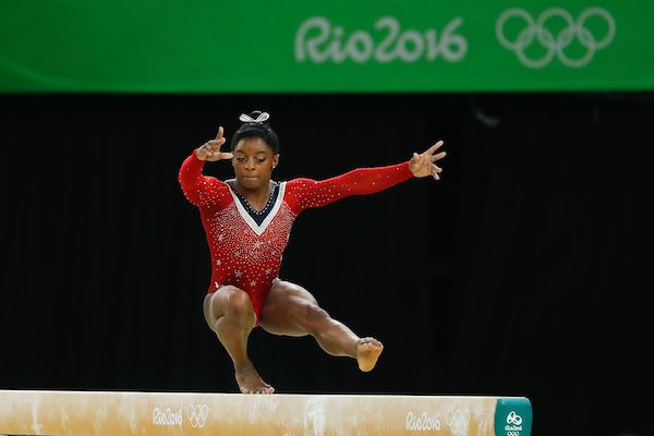 **FILE** Gymnast Simone Biles competes in the balance beam final at the 2016 Summer Olympics in Rio de Janeiro on Aug. 15, 2016. (Agência Brasil Fotografias via Wikimedia Commons)