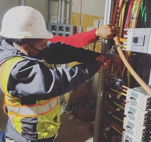 DC Infrastructure Academy graduate Naomi Hawk currently installs solar panels in the District. (Courtesy photo)