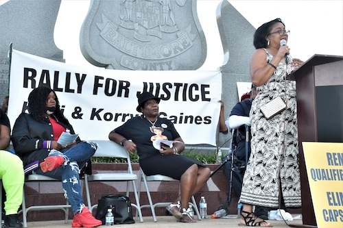Rhanda Dormeus (right) speaks at an Aug. 2 rally in support of her daughter, Korryn Gaines, who was shot and killed by Baltimore County police five years ago. On stage with Gaines is Tamika Palmer (left), mother of Breonna Taylor, who was killed by Louisville police in March 2020, and Marion Gray-Hopkins, whose son Gary Hopkins Jr. was shot and killed by Prince George's County police in November 1999. (Robert R. Roberts/The Washington Informer)