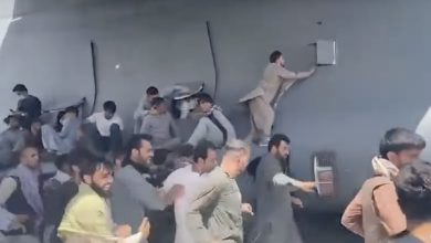 Hordes of Afghans fleeing the Taliban attempt to cling to an American military jet taking off from the tarmac at Hamid Karzai International Airport on Aug. 16. Video of the incident made international news as U.S. President Joe Biden defended his decision to withdraw American troops from Afghanistan, even as the Taliban swiftly regained control of the country. (Screen grab courtesy of Global News)