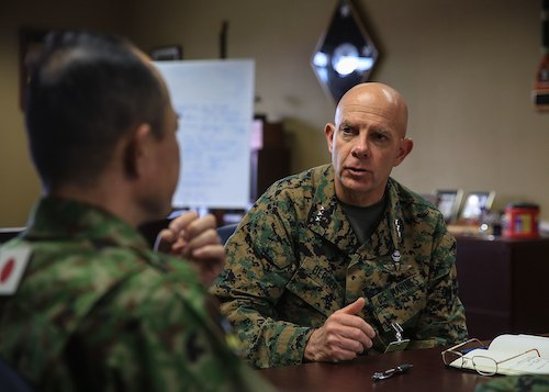 **FILE** U.S. Marine Corps Lt. Gen. David H. Berger converses with Maj. Gen. Shinichi Aoki, Deputy Chief of Staff (Operations) with Western Army, Japan Ground Self-Defense Force, about training exercises taking place during Exercise Iron Fist 2016 at Marine Corps Base Camp Pendleton, Feb. 17, 2016. This is the 11th iteration of the exercise, which continues to provide unique opportunities for the U.S. Marines to train with their Pacific ally on U.S. soil. Iron Fist is an annual, bilateral amphibious training exercise designed to improve USMC and JGSDF's ability to plan, communicate and conduct combined amphibious operations at the platoon, company and battalion levels.