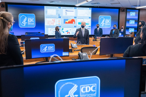 **FILE** President Joe Biden, joined by Vice President Kamala Harris and Director of the Centers for Disease Control (CDC) Dr. Rochelle Walensky, talks with CDC staff during a briefing Friday, March 19, 2021, at the CDC headquarters in Atlanta. (Official White House Photo by Adam Schultz)