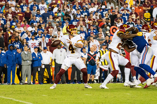 Washington Football Team quarterback Taylor Heinicke attempts a pass during 30-29 win over the New York Giants at FedEx Field in Landover, Md., on Sept. 16. (Abdullah Konte/The Washington Informer)