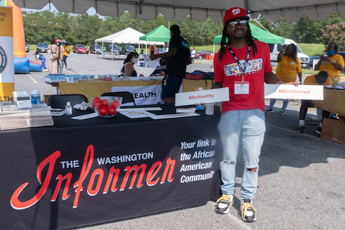 Ward 8 Council member Trayon White stops by The Washington Informer booth during Places of Worship Advisory Board's health fair on Aug. 28. (Shevry Lassiter/The Washington Informer)