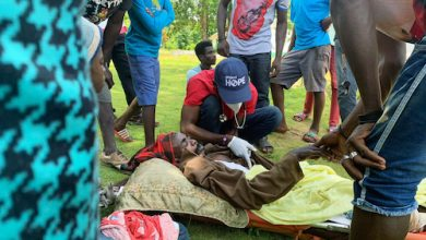Project HOPE team members work to load a landslide survivor onto a U.S. Coast Guard helicopter for transport to Port-au-Prince. The man had been buried in a landslide for a week and had a broken femur and was suffering from dehydration and hunger. (Courtesy of Project Hope)