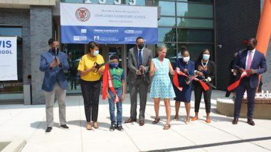 From left: Department of General Services Director Keith Anderson, D.C. Mayor Muriel Bowser, West Education Campus student Henry Levenstein, D.C. Public Schools Chancellor Lewis Ferebee, ANC Commissioner Maria Barry (SMD 4C02), D.C. Council member Janeese Lewis George (D-Ward 4), West Education Campus Principal Lakeysha Jackson and late Rep. John Lewis's chief of staff Michael Collins cut the ribbon for the newly constructed school. (Roy Lewis/The Washington Informer)