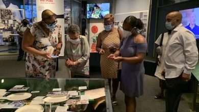 """Vivian Williams and family visit the """"Food for the People"""" exhibition. (Samir Meghelli/Smithsonian Anacostia Community Museum)"""