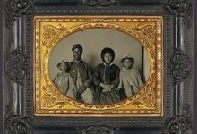 Unidentified African American soldier in Union uniform with wife and two daughters (Library of Congress via Smithsonian)