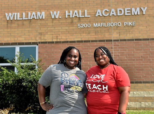 Elementary school teachers and sisters Theresa Wood (left) and Maria Wood stand outside William W. Hall Academy in Capitol Heights. (Robert R. Roberts/The Washington Informer)