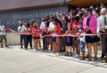 Principal Anita Berger, D.C. Mayor Muriel Bowser and bevy of public officials and community members cut the ribbon for the new Banneker Academic High School on Aug. 28. (Sam P.K. Collins/The Washington Informer)