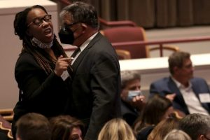 Third-party candidate Princess Blanding drove five hours from Middlesex, Virginia, to attend the gubernatorial debate on Sept. 28, only to be escorted out of the room after attempting to interrupt the event. (Pool photo/Win McNamee-Getty Images)