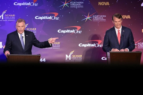Democratic candidate Terry McAuliffe (left) debates with Republican candidate Glenn Youngkin during the Virginia gubernatorial debate at Northern Virginia Community College in Alexandria on Sept. 28. (Pool Photo/Win McNamee-Getty Images)