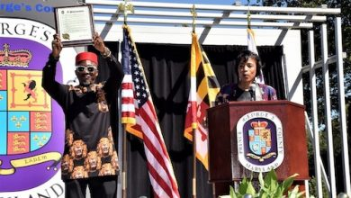 C. Vincent Iweanoge (left) holds a proclamation declaring the month of September as African Heritage Month in Prince George's County on Sept. 24. County Executive Angela Alsobrooks (right) made the announcement in Largo. (Robert R. Roberts/ The Washington Informer)