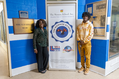 Traque Shepherd (left), a senior at The Monroe School, and The Monroe School Founding Executive Director Dr. Ruth Logan stand in front of The Monroe School. (Photo by Ja'Mon Jackson)