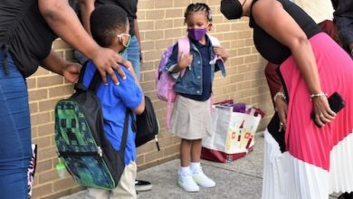 Prince George's County Public Schools CEO Monica Goldson (right) chats with a student outside Deerfield Run Elementary in Laurel on Sept. 8, the county's first day of school. (Robert R. Roberts/The Washington Informer)