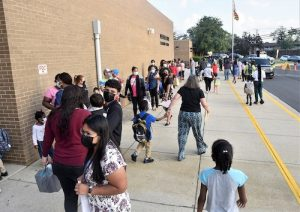 Parents stand in line to drop off their children at Deerfield Run Elementary in Laurel on Sept. 8, the county's first day of school. (Robert R. Roberts/The Washington Informer)