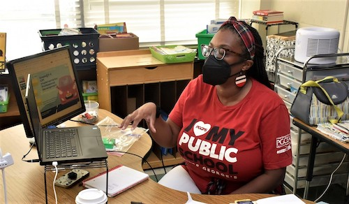 Natasha Rubin, a fourth grade reading, language arts and social studies teacher at Capitol Heights Elementary, explains some of the professional development she and her colleagues will receive this year. (Robert R. Roberts/The Washington Informer)