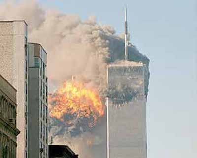 Terrorist-led airplanes crash into the World Trade Center in New York. (Courtesy of Robert J. Fisch via Wikimedia Commons)