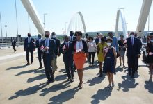 D.C. Mayor Muriel Bowser with Ward 6 Council member Charles Allen and city officials and supporters walk across the newly opened Frederick Douglass Bridge as they prepared for the ribbon-cutting on Sept. 7. (Roy Lewis/The Washington Informer)