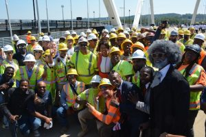 Mayor Muriel Bowser, Ward 8 Council member Trayon White, a Frederick Douglass character along with construction workers celebrate the completion and opening of the Frederick Douglass Bridge on Tuesday, Sept. 7. (Roy Lewis/The Washington Informer)