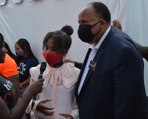 Martin Luther King III looks on as his daughter, Yolanda 13 is interviewed at the March for Voting Rights on Aug. 28 in D.C. (Roy Lewis/The Washington Informer)