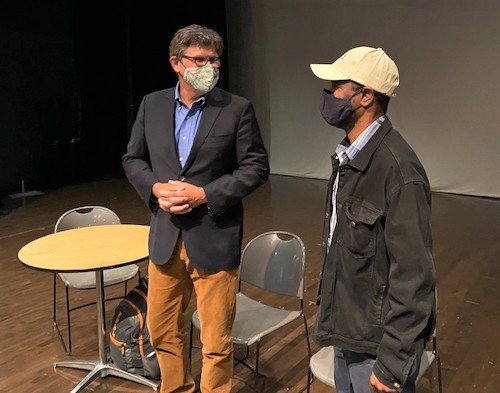 William G. Thomas III (left) and Psalmayene 24 chat at Joe's Movement Emporium in Mount Rainier, Maryland, on Sept. 9. Both will participate in a project to highlight the legacy of slavery in the United States. (William J. Ford/The Washington Informer)
