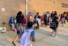 Deerfield Run Elementary School Assistant Principal Nicole Scott helps parents and students line up at the Laurel, Maryland, school on Sept. 8, the first day of classes in Prince George's County. (Robert R. Roberts/The Washington Informer)