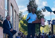 Former President Barack Obama (right) speaks during a campaign rally for Virginia gubernatorial candidate Terry McAuliffe (left) at the campus of the Virginia Commonwealth University in Richmond on Oct. 23. (Dorothy Rowley/The Washington Informer)